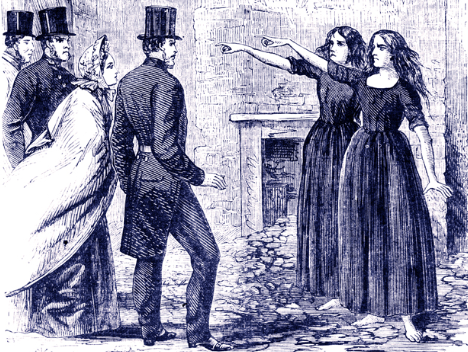 three men in top hats and coattails and a woman in a shawl stand opposite two women in dark dresses and unbound hair